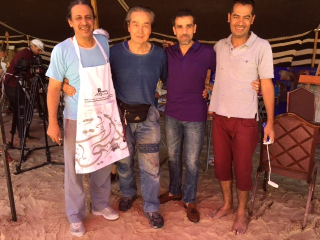Emad Altaay with fellow participants of the Al Asmakh International Symposium of Arts 2015, Qatar, photo artist's own.